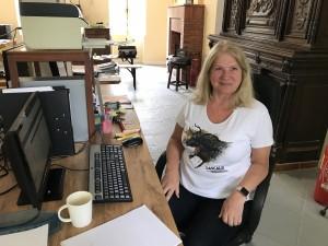 Jan volunteering at her application desk