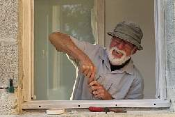volunteer repairing windows